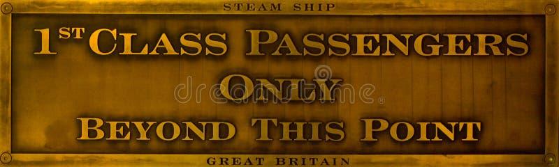 第1个黄铜选件类乘客符号 库存照片