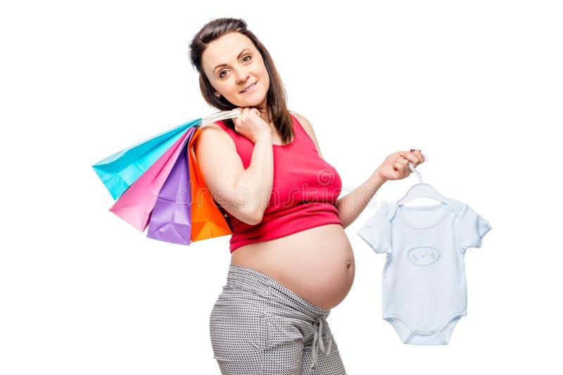 等待她的儿子的诞生妇女,在购物以后的画象 库存照片