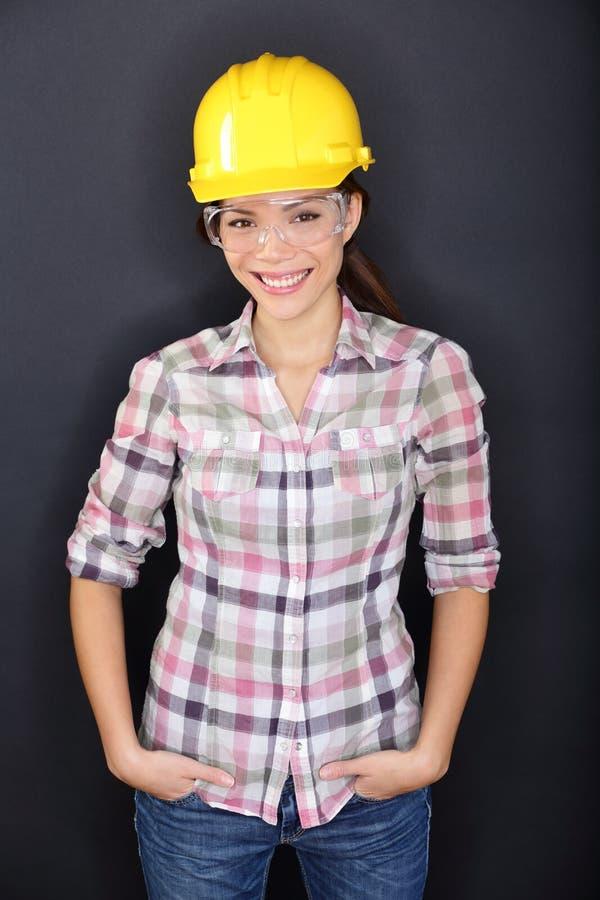 建筑工人愉快的妇女画象 库存图片