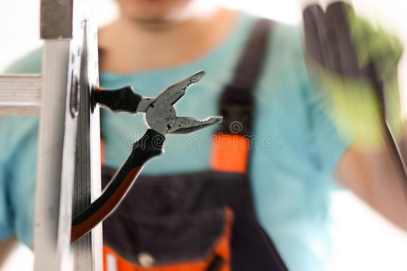 建筑的概念 电工和钳子 免版税库存照片
