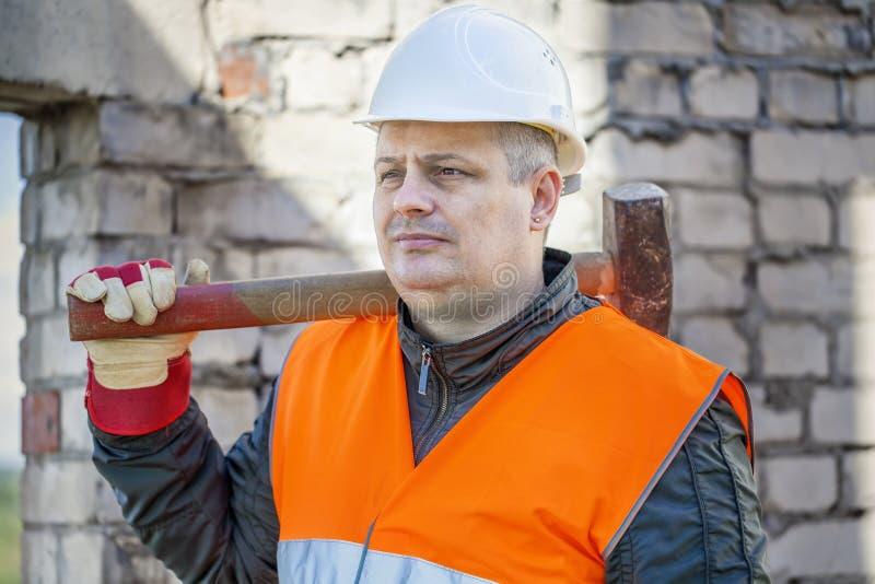 建筑锤子爬犁工作者 免版税库存图片