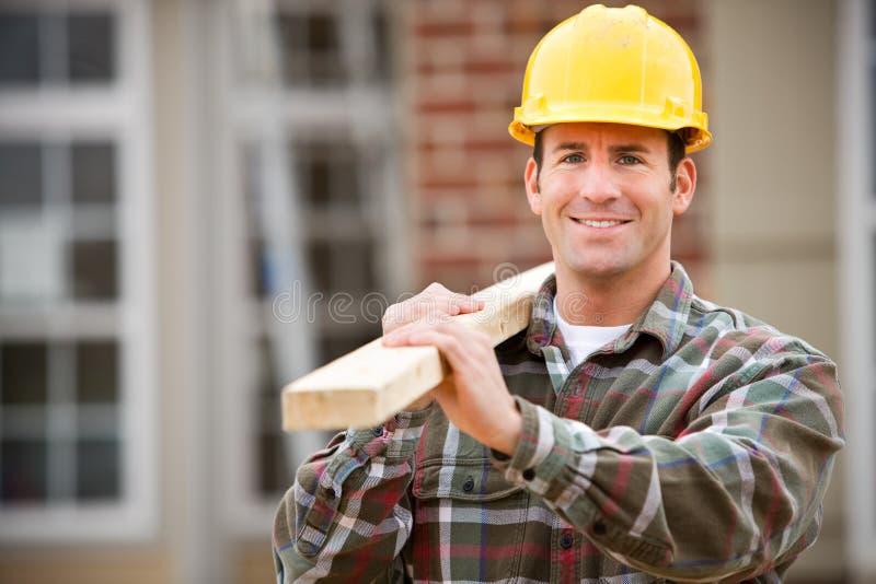 建筑:快乐的建筑工人 库存图片
