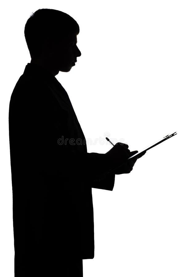 签署文件的商人的剪影 库存照片
