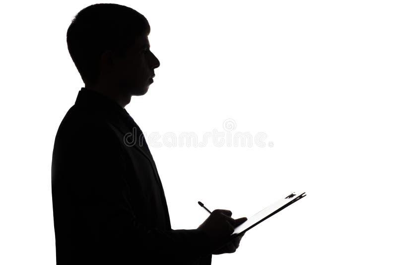 签署贷款的商人的剪影 免版税库存图片