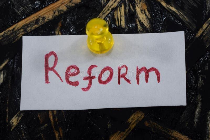 简单和可理解的题字,改革 免版税库存照片