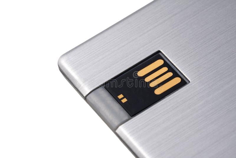 简单的现代银色金属USB驱动,在白色背景隔绝的安全数据存储卡片标志特写镜头 图库摄影