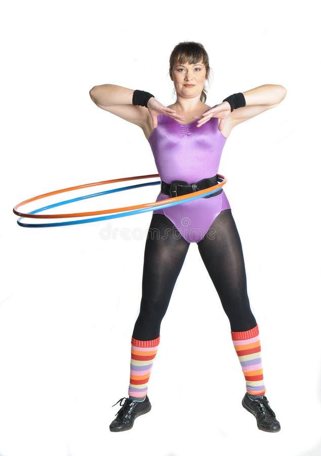 箍hula滚妇女年轻人 免版税图库摄影