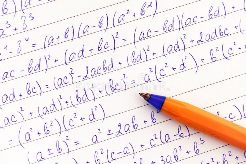 算术惯例和橙色圆珠笔 免版税图库摄影