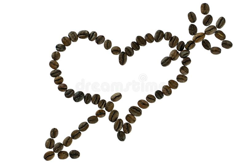 箭头刺穿的咖啡豆心脏 库存照片