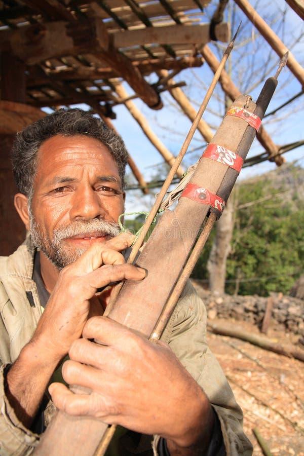 箭头可口可乐枪猎人印度尼西亚语 免版税库存照片