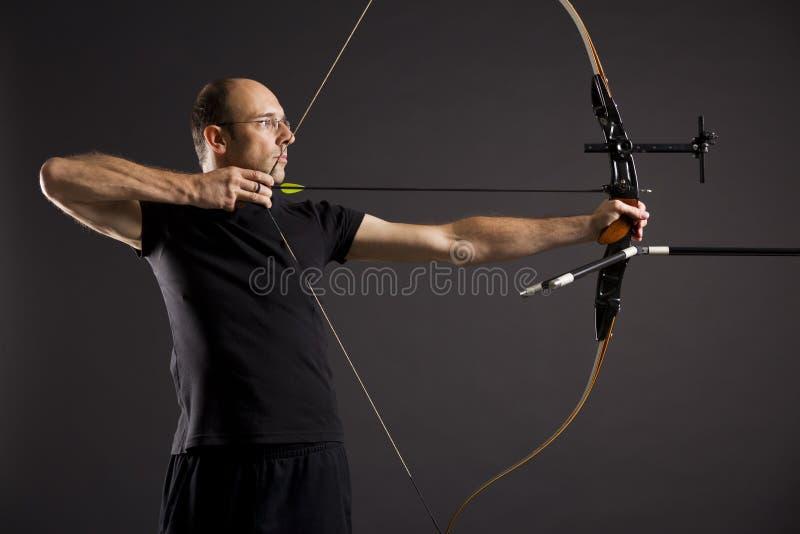 箭头弓前浆手配置文件 免版税库存图片