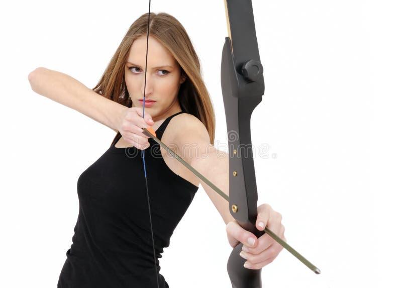 箭头弓射击妇女 免版税库存图片