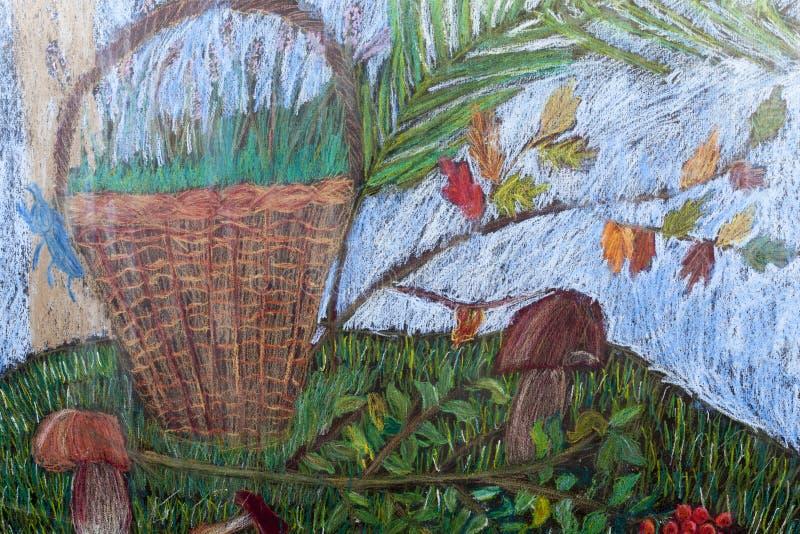篮子用在秋天草甸的蘑菇 库存照片