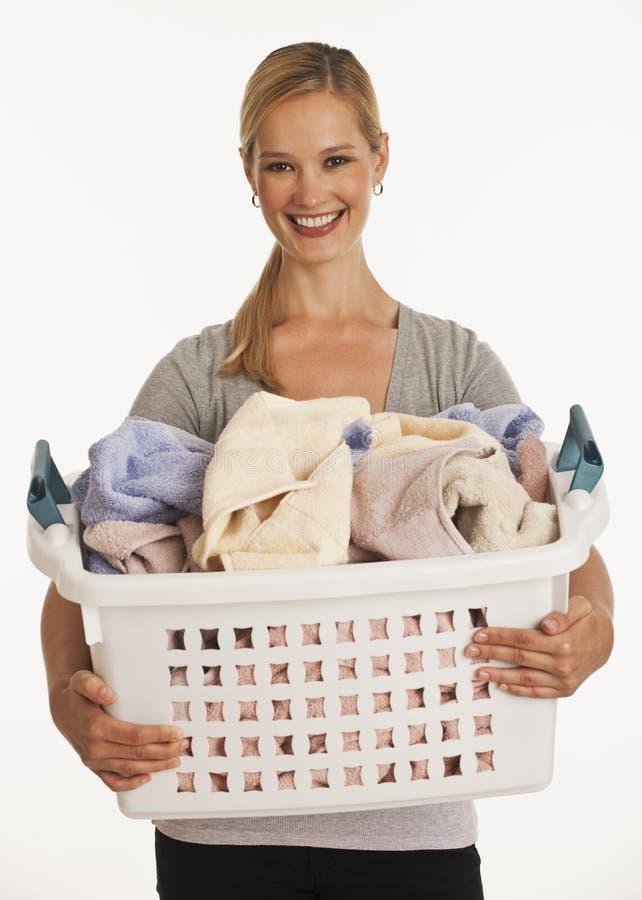 篮子藏品洗衣店妇女年轻人 免版税库存照片