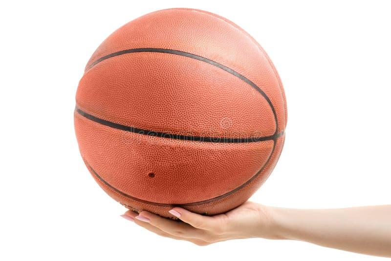 篮球在一只女性手上 库存照片