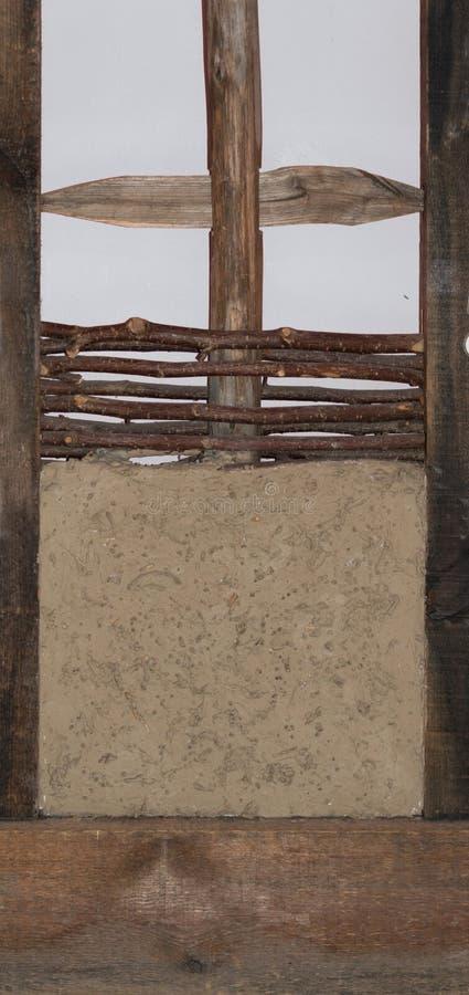 篱笆条和涂抹建筑 免版税库存图片