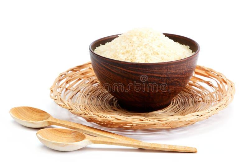 米五谷在碗和木匙子的 库存图片
