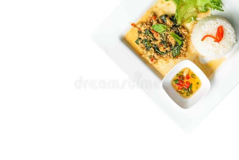 米冠上用混乱油煎的猪肉和蓬蒿 库存照片