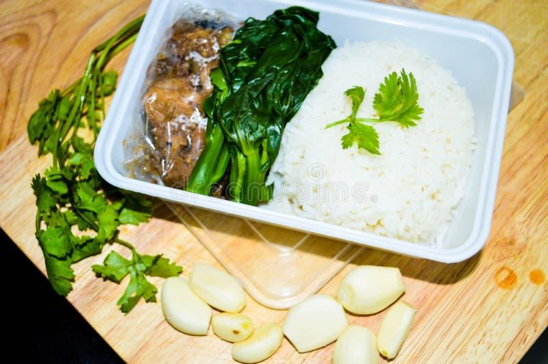 米在箱子的被发酵的猪肉 库存照片