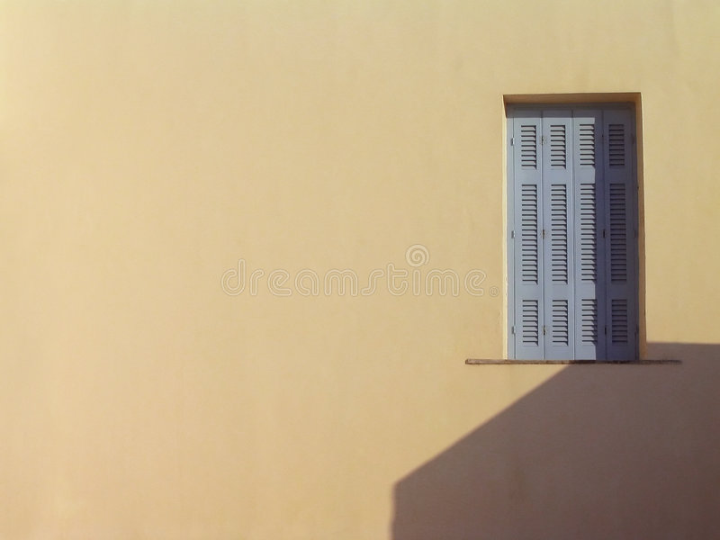 米黄希腊santorini墙壁视窗 免版税库存照片