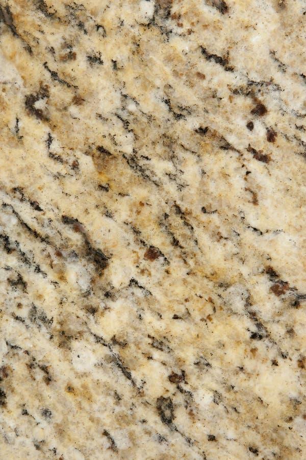 米黄棕色花岗岩表面纹理 免版税库存图片