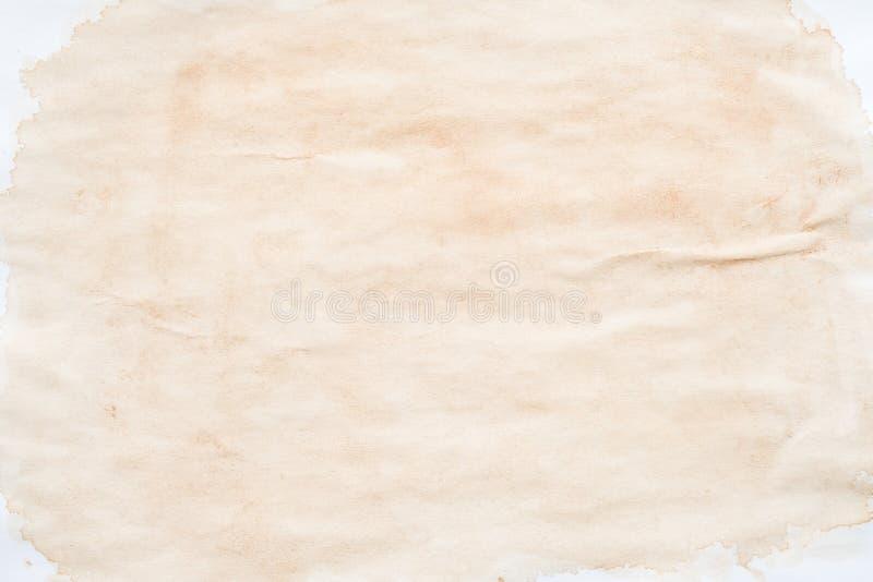 米黄污点被弄脏的纸作用背景 库存图片