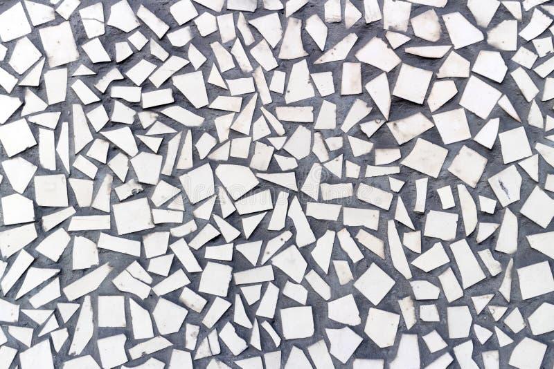 米黄石头铺磁砖不规则形状,背景 免版税库存照片