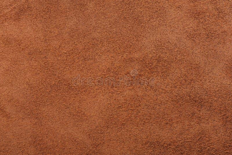 米黄绒面革软的皮革当纹理背景 免版税图库摄影