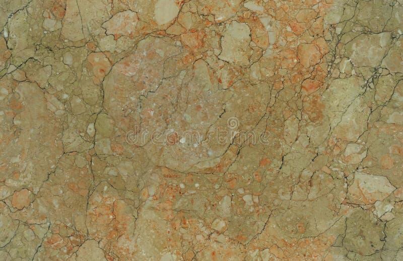 米黄自然无缝的花岗岩大理石石头纹理样式背景 与g的概略的自然石无缝的大理石纹理表面 免版税库存照片