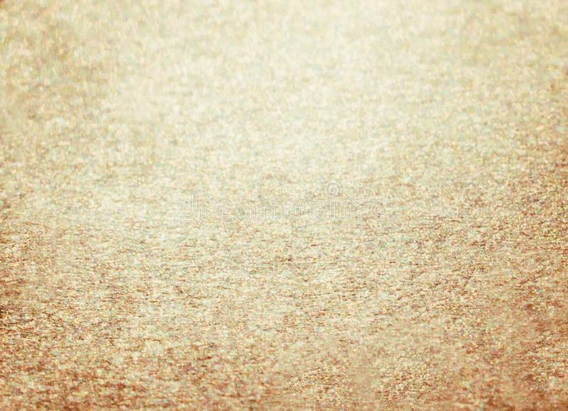 米黄金黄闪烁冬天圣诞节背景 库存照片