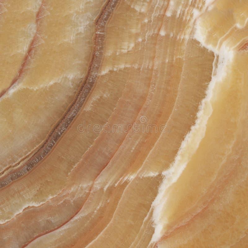 米黄类似玛瑙的条纹大理石,自然石纹理 库存图片