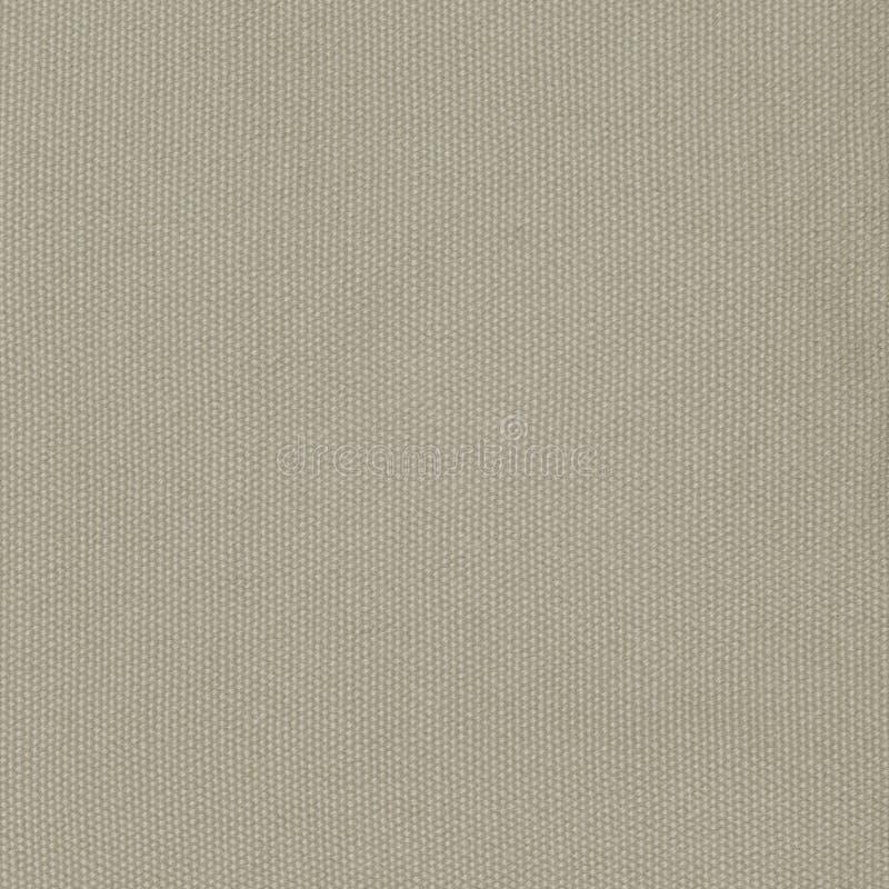 米黄卡其色的棉织物纹理背景详细的宏观特写镜头大垂直的织地不很细亚麻帆布粗麻布拷贝空间样式 免版税库存图片