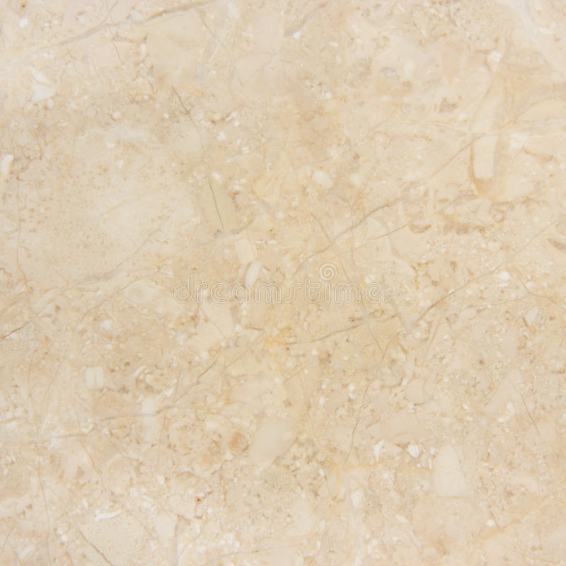 米黄大理石背景。 免版税库存照片