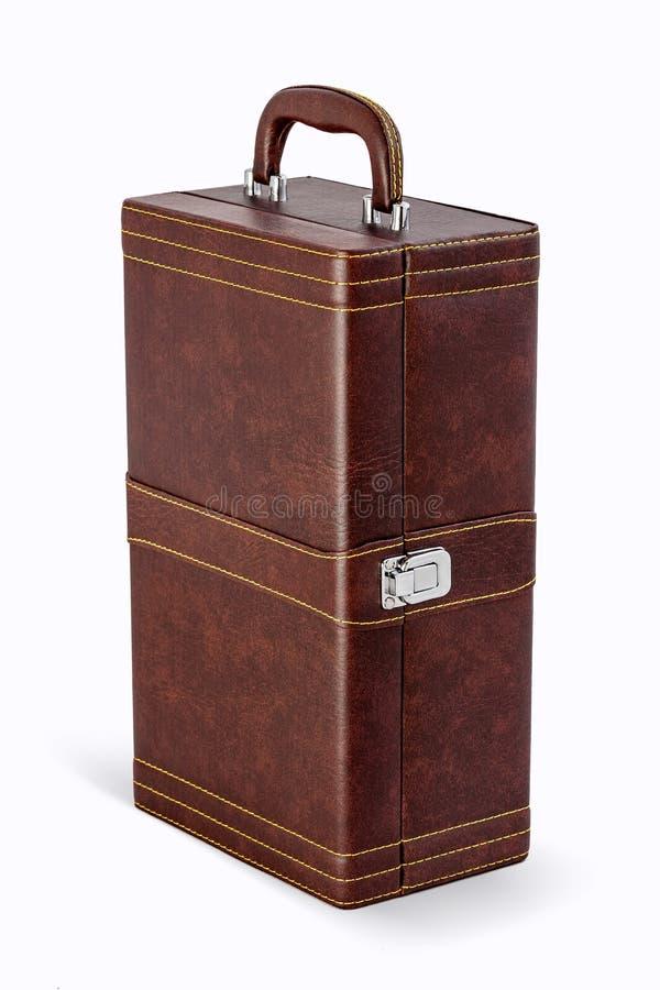 米黄手提箱或袋子在白色背景隔绝的礼物的 库存照片