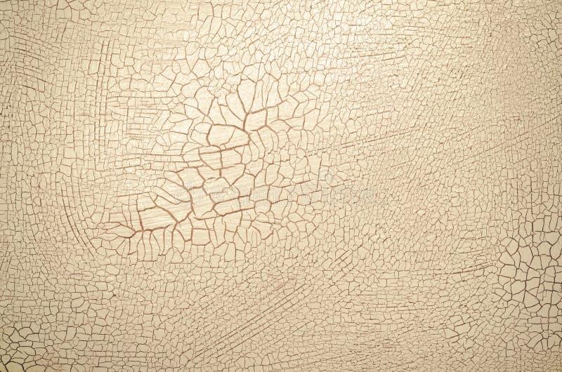 米黄有裂痕的油漆 库存图片