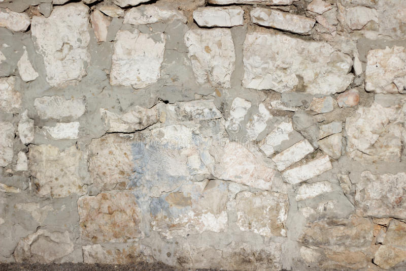米黄老石砖墙纹理 库存图片