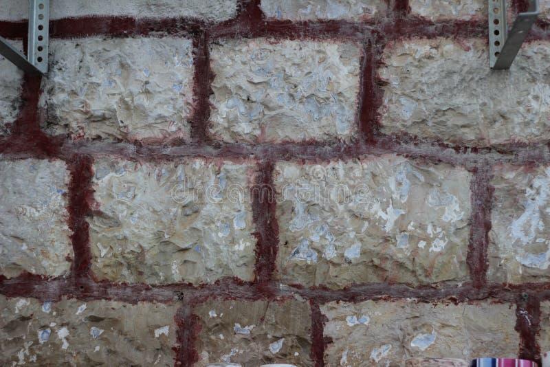 米黄老石砖墙纹理 图库摄影