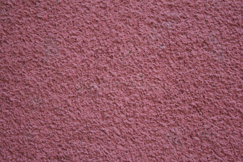 粗砺和粒状带红色墙壁具体纹理 库存图片