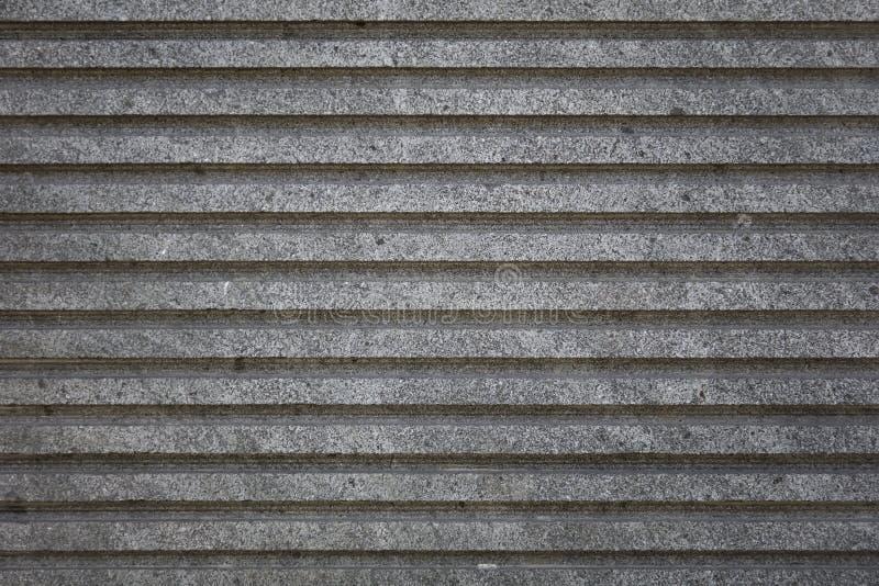 粗砺的灰色具体水泥镶边墙壁 库存照片