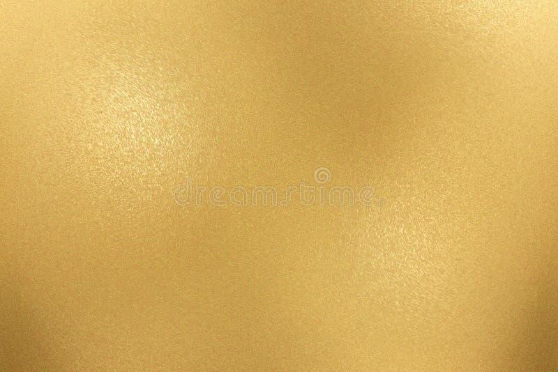 粗砺的金金属板料,抽象背景纹理  免版税库存照片