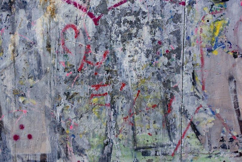 粗砺老肮脏的混凝土墙graffity的难看的东西 免版税库存图片