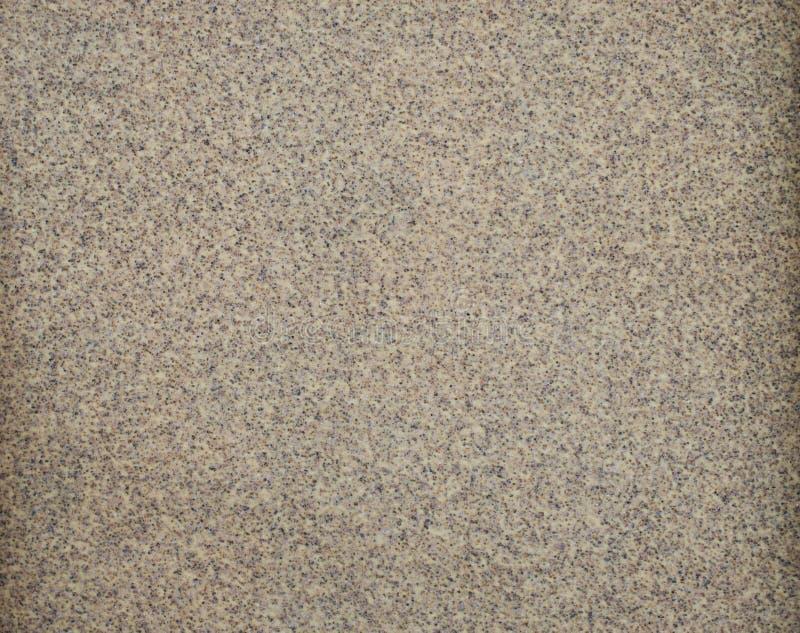粗糙的布朗沙纸背景 库存照片