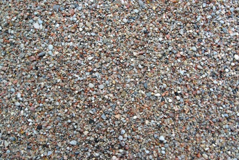 粗糙的河沙子,背景 顶视图 免版税库存照片