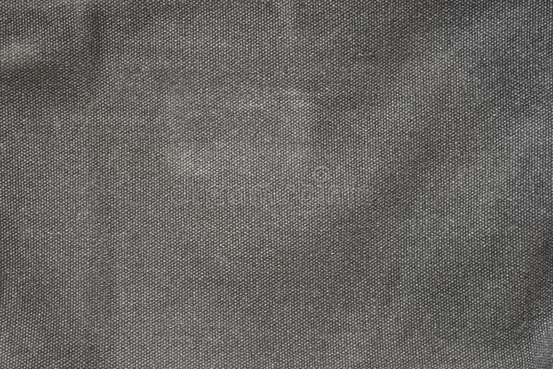 粗糙的深灰织品纺织品纹理背景 免版税库存照片