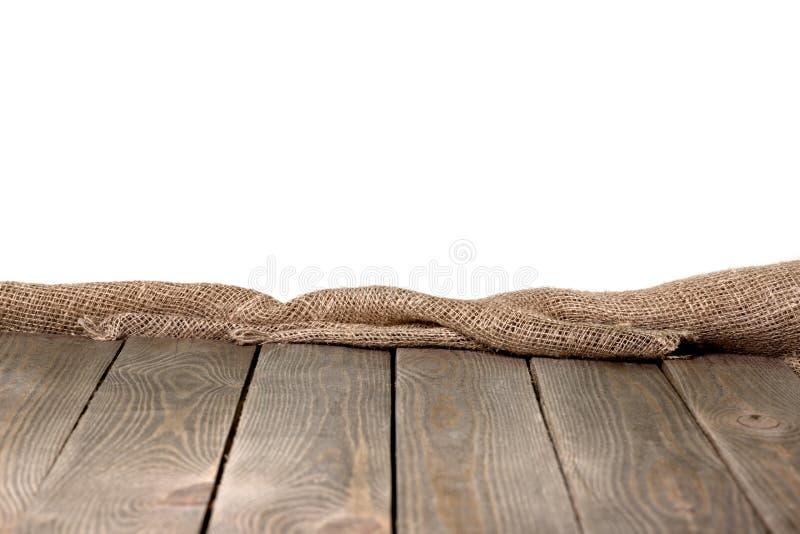 粗麻布粗麻布或袋装在白色木 免版税库存照片