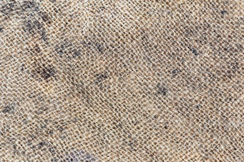 粗麻布纹理或粗麻布背景 黑暗的国家袋装的粗麻布帆布 免版税库存照片