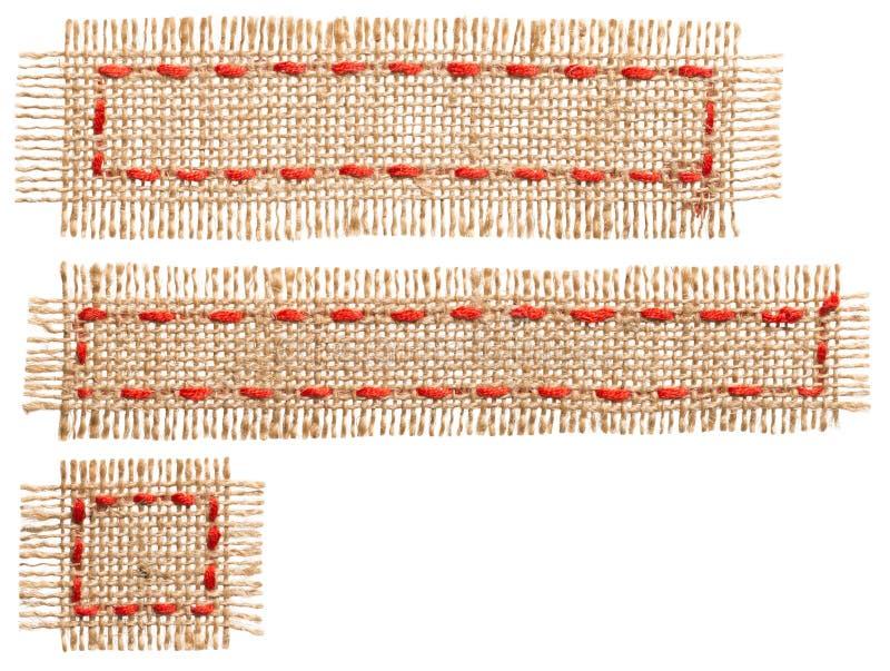 粗麻布织品补丁标签,亚麻制黄麻,苴标记,白色麻袋布丝带被隔绝 库存图片
