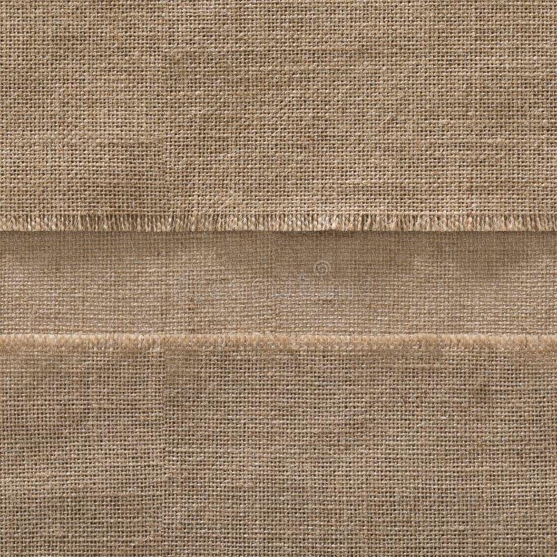 粗麻布无缝的织品边缘背景,小条苴框架 库存照片