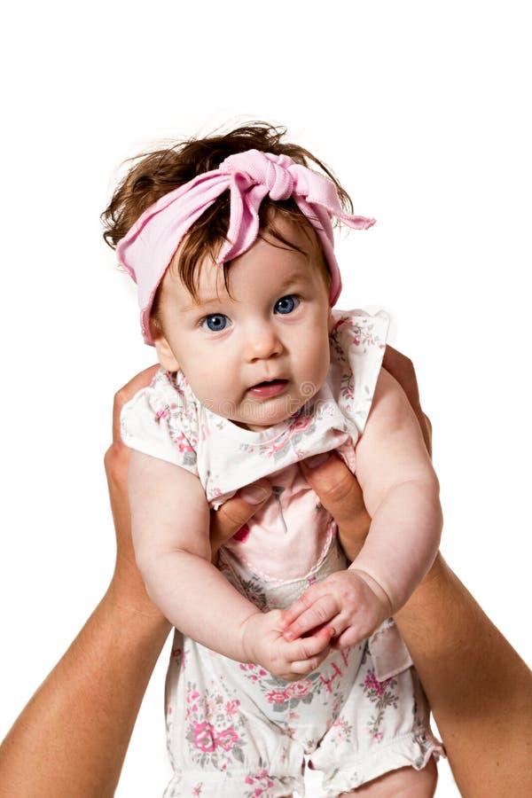精神手拿着女婴 免版税库存图片