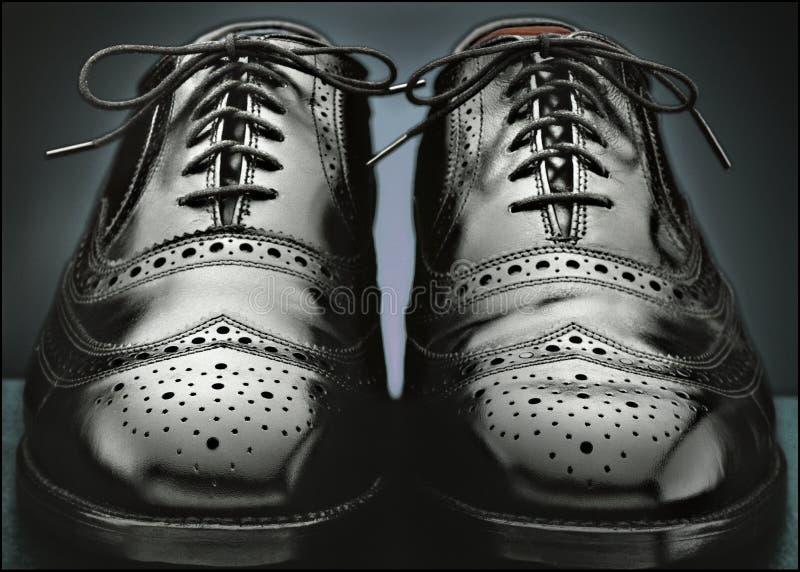 精神黑翼梢鞋子 库存照片